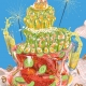 Jello date is an illustration of seafood prepared in Jello in a retro 70s style. The bottom tear features lobster, the medium king prawns and the top vegetables. The entire creation is just about to fall down.