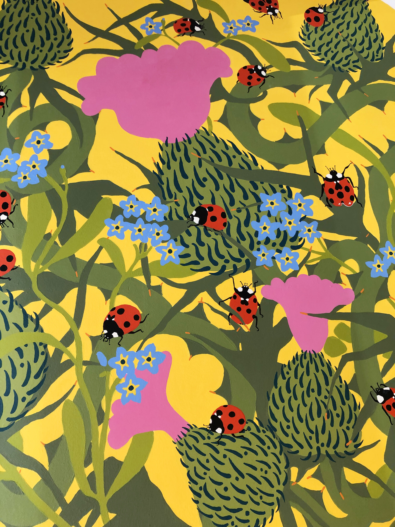 Closeup of Bakery Honeytrap mural showing a ladybird on a thistle plant surrounded by forget-me-not flowers_©Ida Henrich